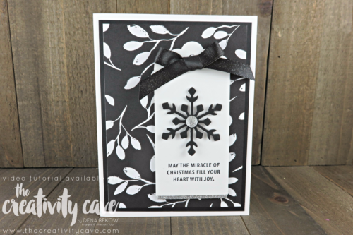Check out the video tutorial for this simple yet stunning Christmas Tag Card using Stampin Up's Snowflake Sentiments stamp set and Trim Your Stocking Framelits on my blog at www.thecreativitycave.com #stampinup #thecreativitycave #christmas #scalloptagtopper #merrylittlechristmasdsp #handmadegreetingcards #rubberstamping #scrapbookpaper #craete