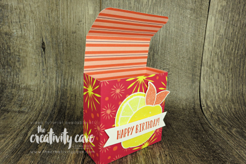 Video tutorial showing how to create this adorable folded treat box using Stampin Up's Lemon Zest Stamp Set  on my blog complete with a scoring template at www.thecreativitycave.com #stampinup #thecreativitycave #treatbox  #happinessbloomsdsp #printedpaper #lemonzest #lemonbuilderpunch