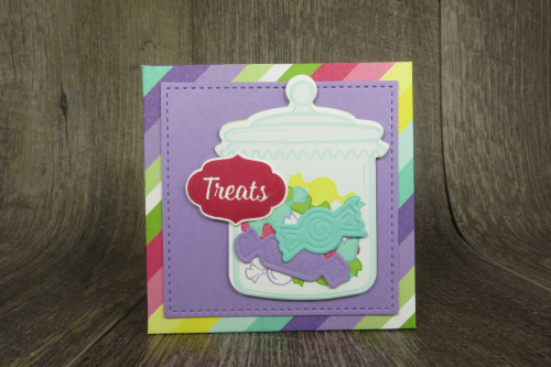Video tutorial showing how to create this adorable folded treat box using Stampin Up's Sweetest Thing Bundle  on my blog complete with a scoring template at www.thecreativitycave.com #stampinup #thecreativitycave #treatbox #sweetestthing #jarofsweetsframelits #framelits #howsweetitisdsp #printedpaper